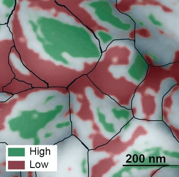 This atomic force microscopy image of the grainy surface of a perovskite solar cell reveals a new path to much greater efficiency. Individual grains are outlined in black, low-performing facets are red, and high-performing facets are green. A big jump in efficiency could possibly be obtained if the material can be grown so that more high-performing facets develop. (Credit: Berkeley Lab)
