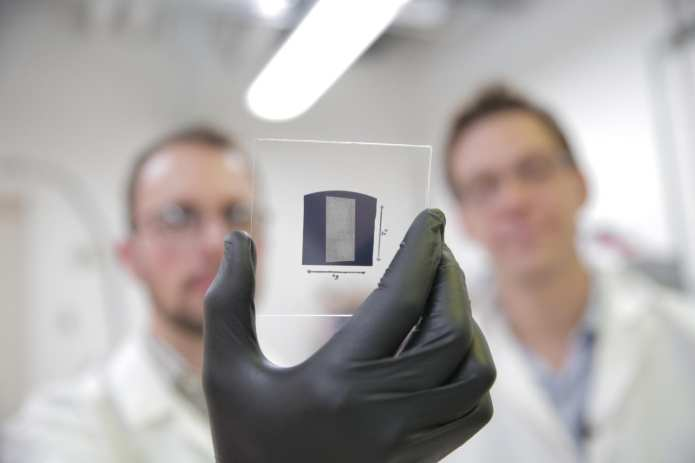 The UW-Madison engineers use a solution process to deposit aligned arrays of carbon nanotubes onto 1 inch by 1 inch substrates. The researchers used their scalable and rapid deposition process to coat the entire surface of this substrate with aligned carbon nanotubes in less than 5 minutes. The team's breakthrough could pave the way for carbon nanotube transistors to replace silicon transistors, and is particularly promising for wireless communications technologies.  CREDIT Stephanie Precourt