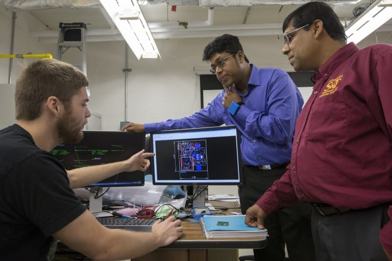 A Missouri S&T team including, from left, graduate student Alec Bayliff, Dr. Debraj De and Dr. Sajal Das, created a wearable device for the wrist that can track a person's movements, environment, bio-signals and more. De is wearing the device. Photo By Sam O'Keefe/Missouri S&T