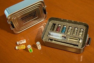 The portable biomolecular manufacturing method, developed by Wyss Institute Core Faculty member James Collins and his team, can produce a broad range of biomolecules, including vaccines, antimicrobial peptides and antibody conjugates, without power or refrigeration. The team envisions that the method's freeze-dried components could be carried in portable kits (such as the mock kit pictured here) for use in the field anywhere in the world. Credit: Wyss Institute at Harvard University