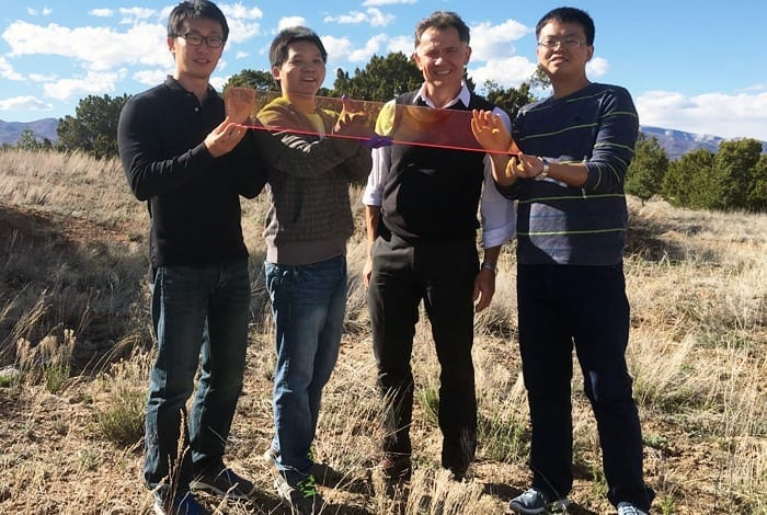 October 11, 2016 Los Alamos Center for Advanced Solar Photophysics researchers hold a large prototype solar window. From left to right: Jaehoon Lim, Kaifeng Wu, Victor Klimov, Hongbo Li. Los Alamos Center for Advanced Solar Photophysics researchers hold a large prototype solar window. From left to right: Jaehoon Lim, Kaifeng Wu, Victor Klimov, Hongbo Li.