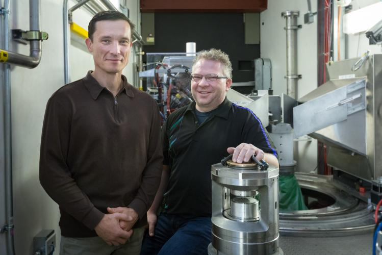 Ilia Ivanov (left) from Oak Ridge National Laboratory's Center for Nanophase Materials Science, Chris Tulk (right) from ORNL's Spallation Neutron Source and their collaborators received unexpected results from a neutron scattering experiment at SNS that could open a new pathway for the synthesis of novel materials and also help explain the formation of complex organic structures observed in interstellar space.
