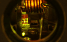 Long-distance quantum communication via a network of crystals