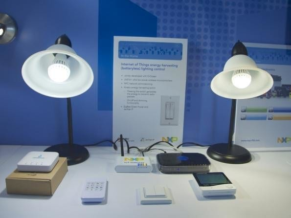 A desk lamp powering devices in the room