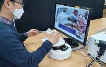 A remote specimen collection robot eliminates direct contact between medical personnel and patients