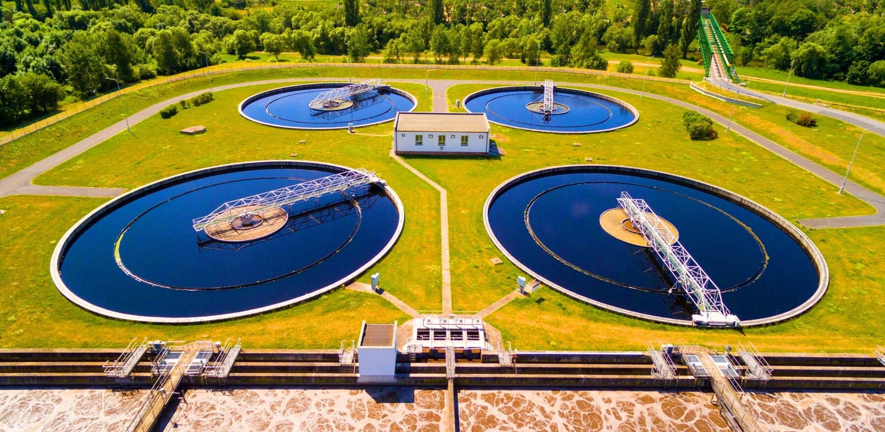 Aerial view to sewage treatment plant. Grey water recycling. Waste management in European Union. Environmentally theme.