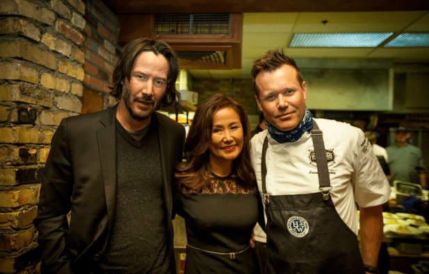 (From left to right) Keanu Reeves, Mimi Kim chat in the kitchen with famed chef Brian Malarkey at ChefDance 2017, sponsored by GiftedTaste, Park City, Utah