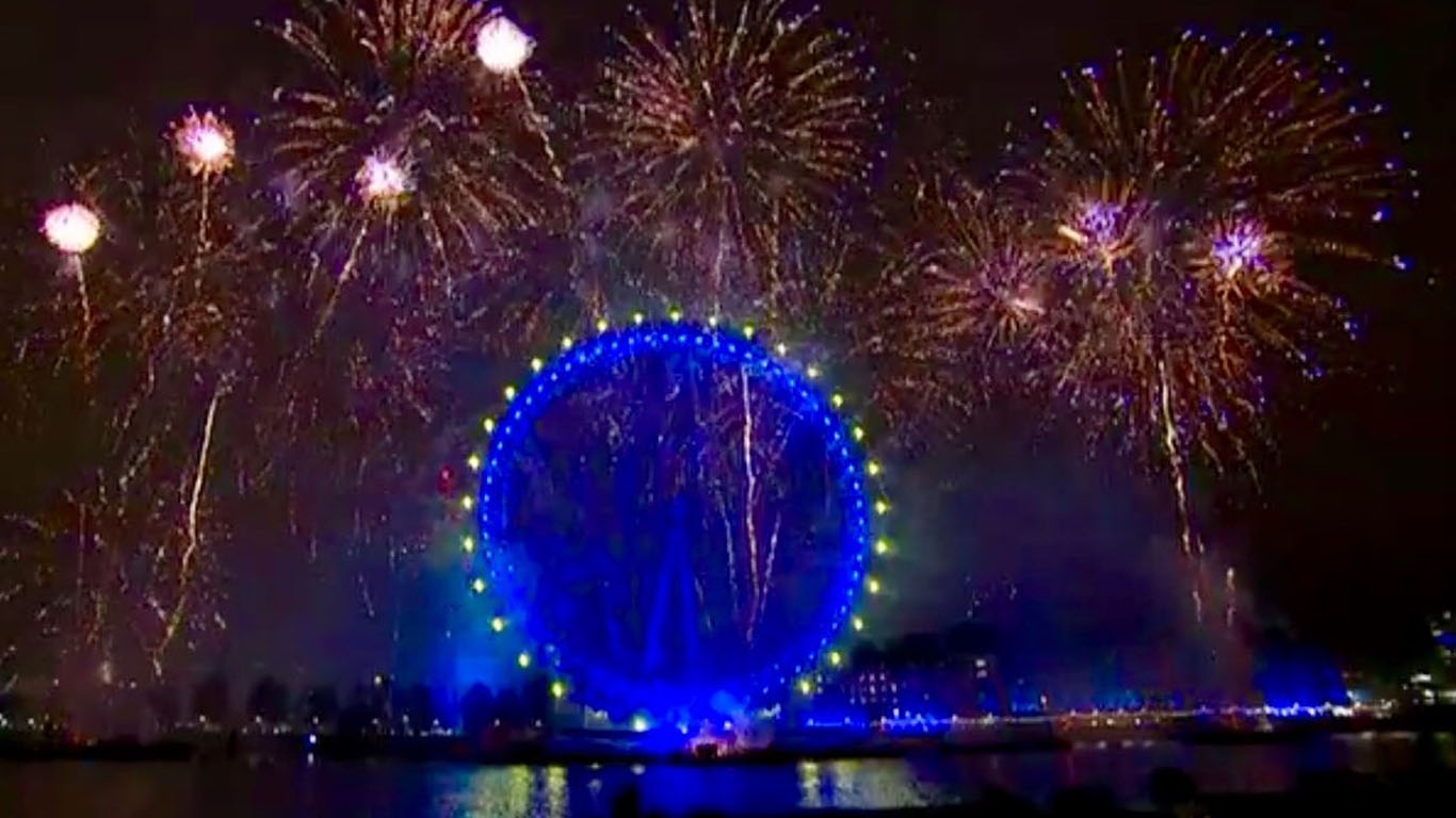 Photo of London Eye at night under fireworks