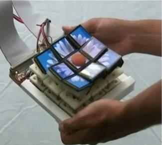 Tela mecanicamente 3D move o mundo à sua frente