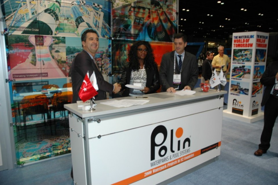 Princess Abiodun Oyefusi, Managing Director for Delta Leisure Resorts, signs agreements with Polin representatives.