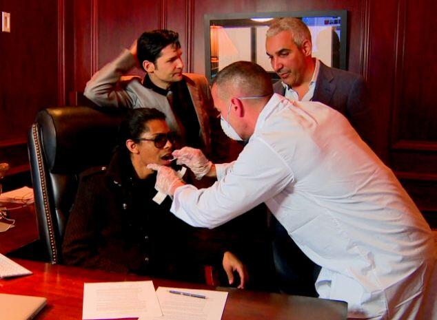 Brandon Howard (getting DNA swab), actor Corey Feldman, Alki David in publicity photo
