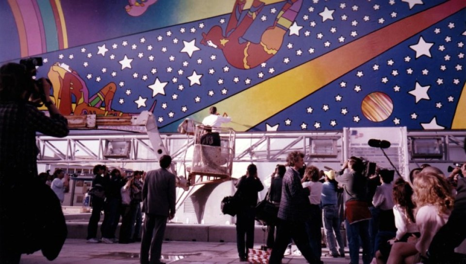 Peter Max signs the murals he created for the US Pavilion at Seville Expo 92. Photo courtesy James Ogul.