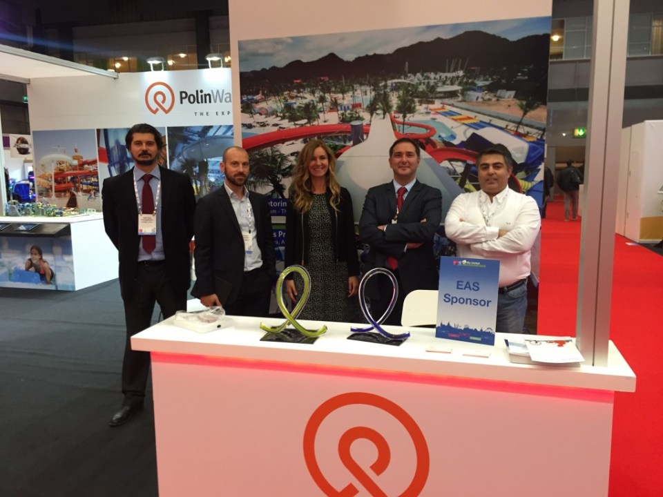 Polin staff pose in their EAS booth