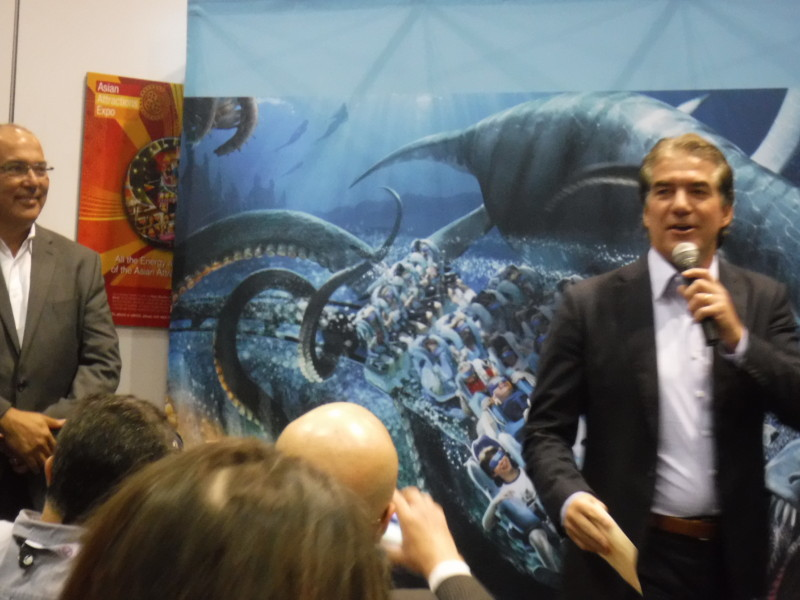 SeaWorld Chief Creative Officer Anthony Esparza watches as Joel Manby describes Kraken VR