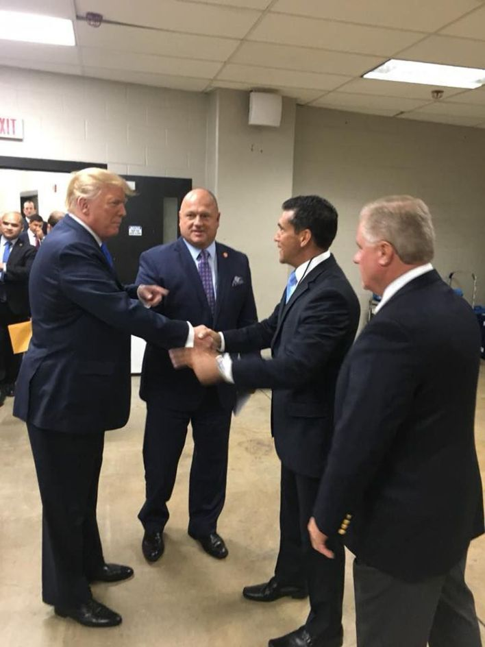 "Pennsylvania Republican Party Chairman Valentino ""Val"" DiGiorgio shakes hands with President Donald Trump as David Urban (center), a lobbyist who advised Trump's 2016 campaign in the state looks on with Scott Wagner, the 2018 Republican nominee for governor. Trump was in Wilkes-Barre to appear at an Aug. 2, 2018 political rally, in this photo posted to DiGiorgio's Facebook page."