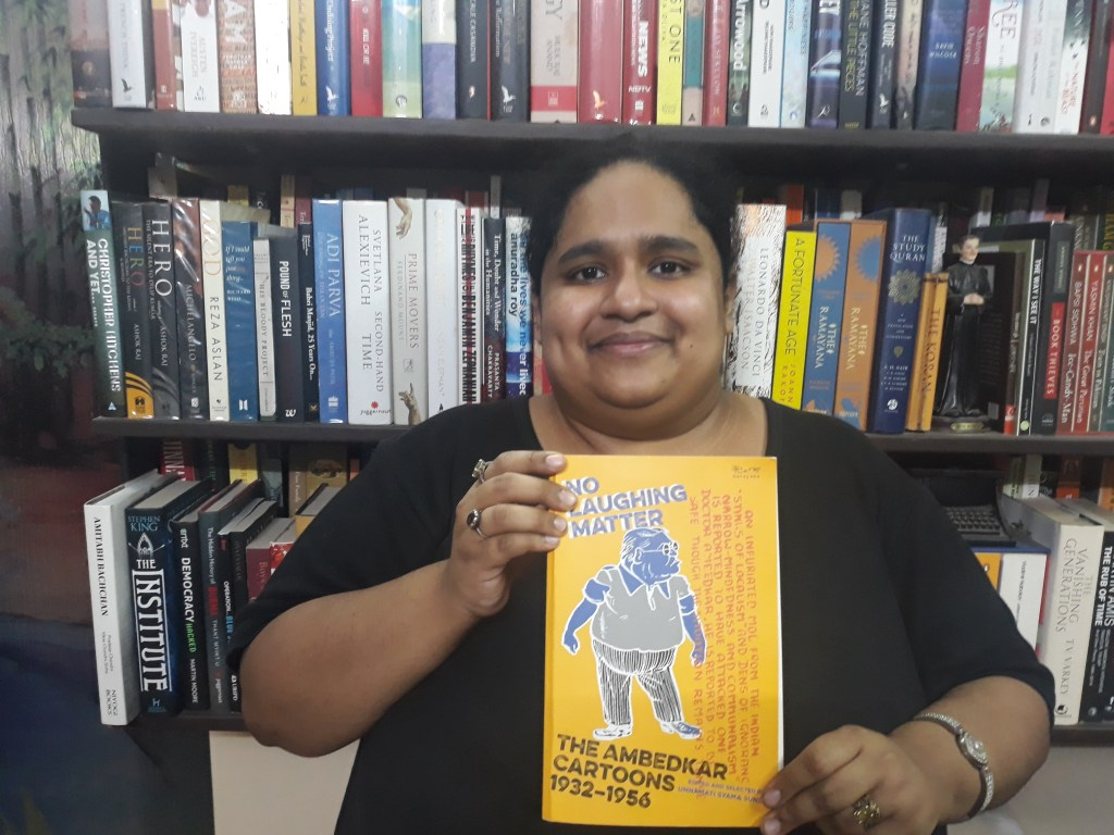 Fiza Pathan posing with the book No Laughing Matter