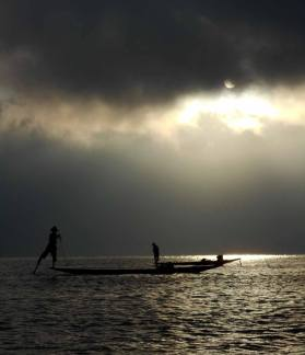 Leg-rowing fishermen