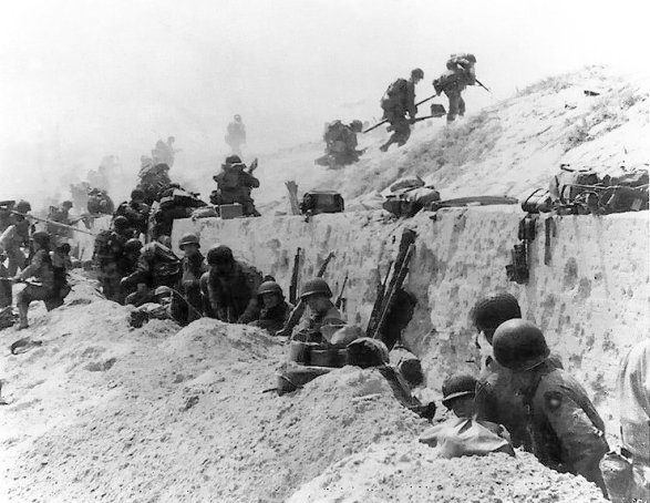 Troops advance over the sea wall at Utah Beach during Operation Overlord.