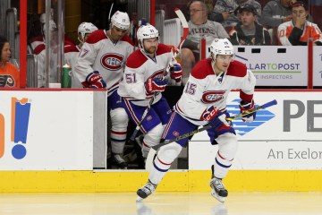 Right Wing Pierre-Alexandre Parenteau (#15), Center David Desharnais (#51) and Right Wing Rene Bourque (#17) of the Montreal Canadiens emerge from the tunnel