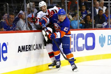NY Islanders Anders Lee checks NJ Devils Andy Greene. (Brandon Titus/ Inside Hockey)
