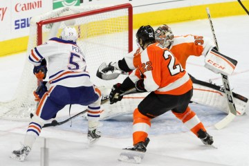 Left Wing David Perron (#57) of the Edmonton Oilers tries to knock the puck into the net