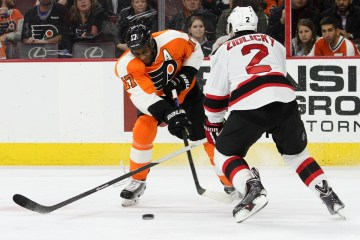 Right Wing Wayne Simmonds (#17) of the Philadelphia Flyers shoots the puck through Defenseman Marek Zidlicky (#2) of the New Jersey Devils