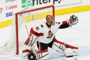 The puck sails high over the glove of Goalie Craig Anderson (#41) of the Ottawa Senators
