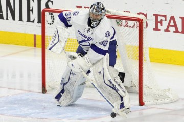 Goalie Ben Bishop (#30) of the Tampa Bay Lightning plays the puck