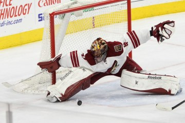 Goalie Mike Smith (#41) of the Arizona Coyotes makes an acrobatic save