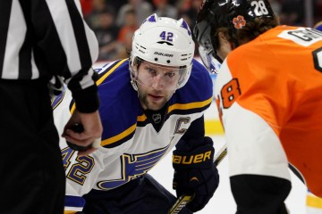 Center David Backes (#42) of the St Louis Blues waits for the puck to be dropped during a face-off against Center Claude Giroux (#28) of the Philadelphia Flyers