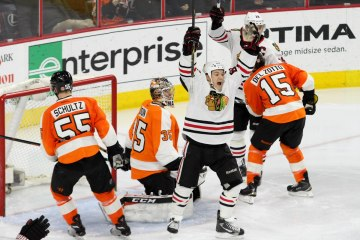 Center Andrew Shaw (#65) of the Chicago Blackhawks celebrates his goal scored against Goalie Steve Mason (#35) of the Philadelphia Flyers