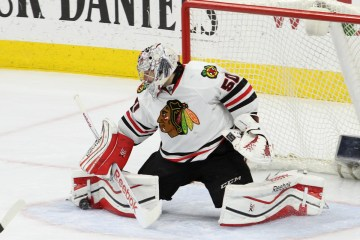 Goalie Corey Crawford (#50) of the Chicago Blackhawks makes a leg pad save