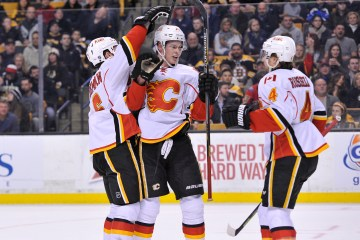 Calgary Flames celebrate their first period goal during an NHL game at the TD Garden. The Flames beat the Bruins 4-3 in a shootout. (Photo: Brian Fluharty)