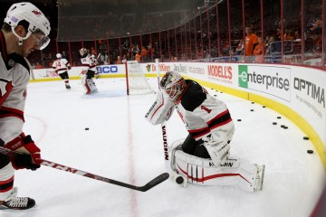Defenseman Eric Gelinas (#44) shoots the puck against Goalie Keith Kinkaid (#1) of the New Jersey Devils during the warm-ups