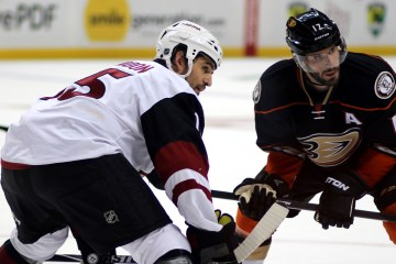Boyd Gordon (#15) and Ryan Kesler (#17) prepare for the faceoff