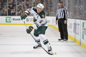 Minnesota Wild defenseman Ryan Suter (20) passes the puck during a NHL game on November 19th, 2015. (Brian Fluharty/ Inside Hockey)