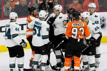 Defenseman Justin Braun (#61) of the San Jose Sharks and Center Claude Giroux (#28) of the Philadelphia Flyers exchange words during the second period