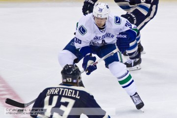 Janik Hansen (VAN - 36) skates the puck past Scott Hartnell (CBJ - 43).