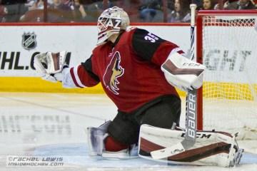 Louis Domingue (AZ - 35) makes a glove save.  The Arizona Coyotes shut out the Nashville Predators 4-0 Saturday, January 9, 2016 at Gila River Arena in Glendale, AZ.  (Rachel Lewis - Inside Hockey)