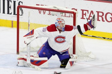 Goalie Mike Condon (#39) of the Montreal Canadiens makes a glove save during the third period