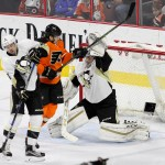 The puck sails over the head of Goalie Marc-Andre Fleury (#29) of the Pittsburgh Penguins during the first period