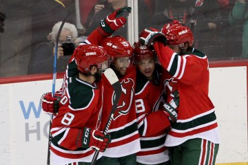 Defenseman David Schlemko (#8), Left Wing Stefan Matteau (#25), Center Tyler Kennedy (#48), and Defenseman Jon Merrill (#7) of the New Jersey Devils celebrate a goal during the second period