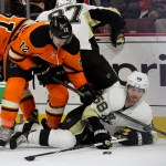 Right Wing Michael Raffl (#12) of the Philadelphia Flyers and Defenseman Kris Letang (#58) of the Pittsburgh Penguins battle for the puck during the second period