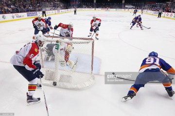 in Game Six of the Eastern Conference First Round during the 2016 NHL Stanley Cup Playoffs at the Barclays Center on April 24, 2016 in the Brooklyn borough of New York City. The Islanders won the game 2-1 in double overtime to win the series four games to two.