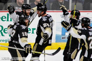 Jarrett Burton (WHL - 20) celebrates his goal with teammates.
