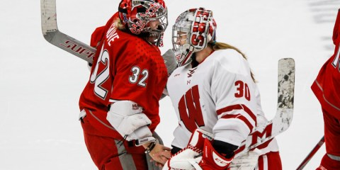 Kassidy Sauve (OSU - 32) shakes hands with Ann-Renee Desbiens.  Sauve faced 38 shots on net, whereas Desbiens faced 7.  Each allowed one goal in regulation.