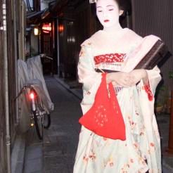 A maiko (trainee geisha) on the streets of Gion
