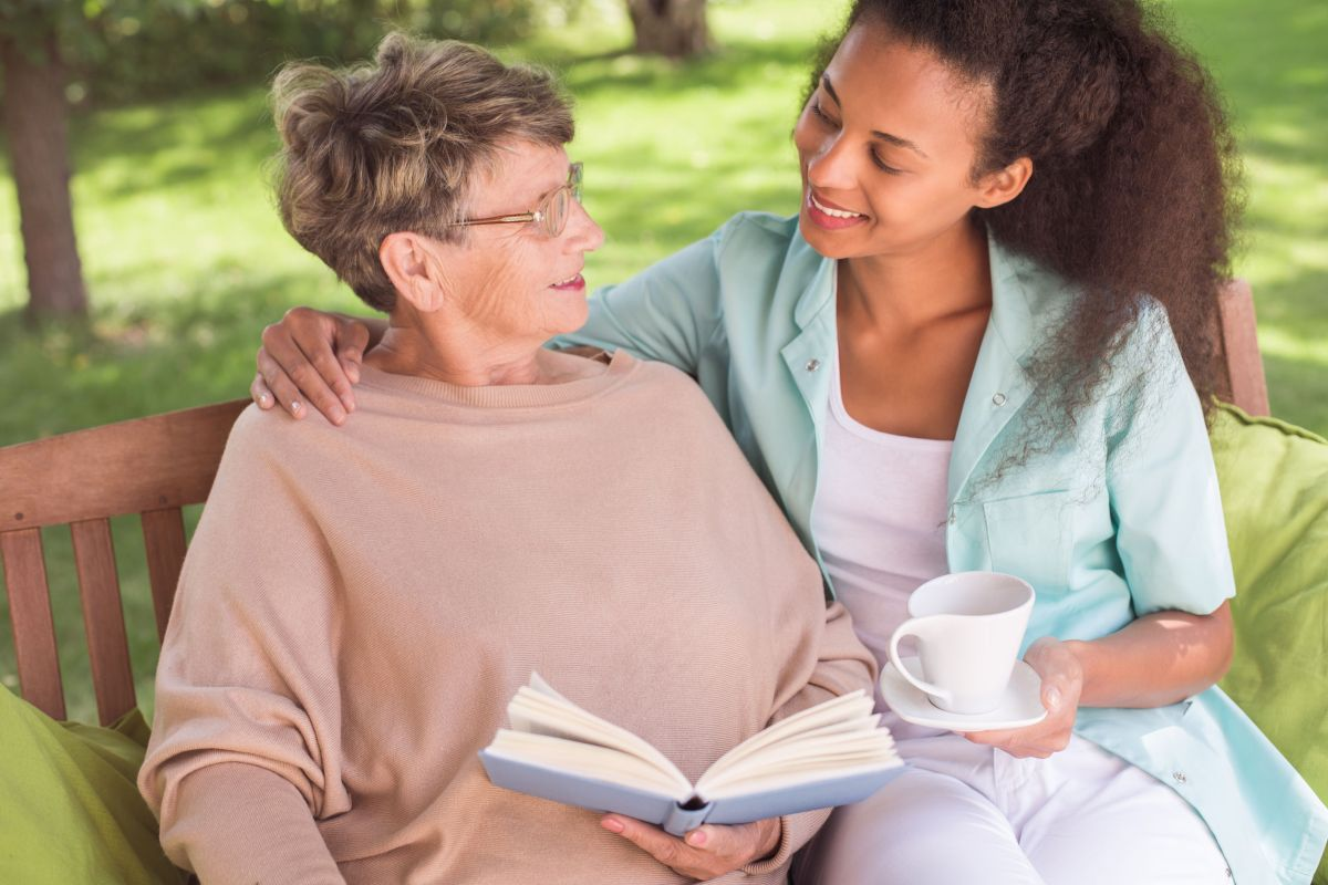 43697788 - senior woman and young carer being friends