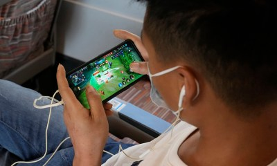 Parents in China laud rule limiting video game time for kids