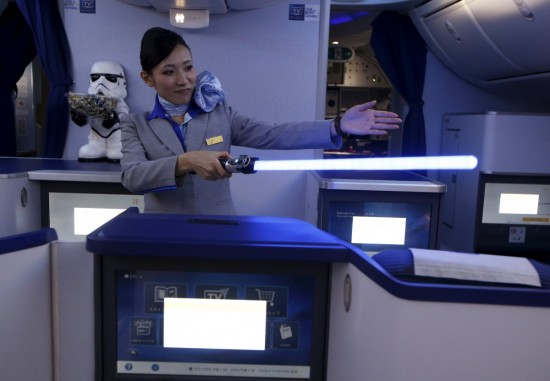a-stewardess-uses-a-light-saber-to-demonstrate-the-features-of-the-business-class-section-during-november-the-plane-will-be-flying-domestic-routes-in-japan
